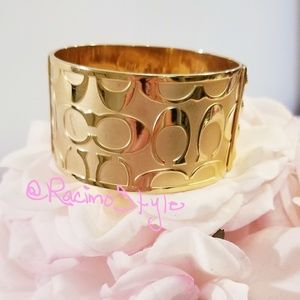 Coach gold toned wide bangle